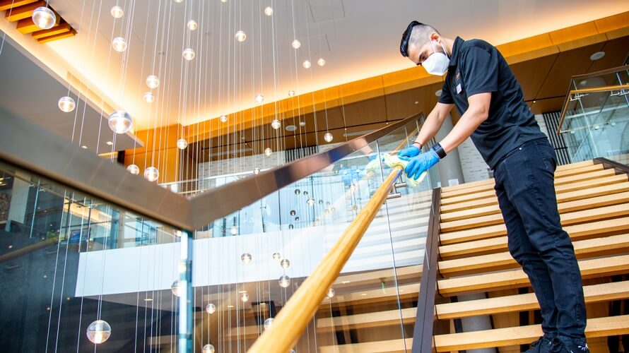 employee cleaning in Hilton hotel