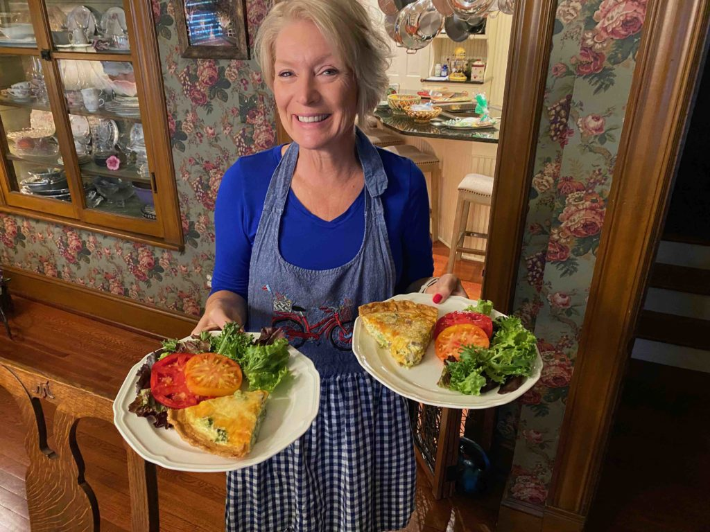 Alice Muellerweiss serving quiche at Hopewell House
